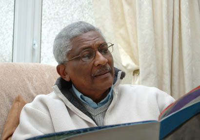 photo of a senior man reading a magazine