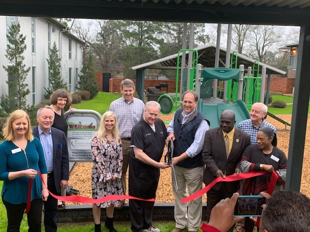 Mission First group cutting ribbon at playground